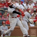Cincinnati Reds' Brandon Phillips hits an RBI double during the ninth inning of a baseball game against the St. Louis Cardinals, Monday, April 8, 2013, in St. Louis. The Reds won 13-4. (AP Photo/Jeff Roberson)