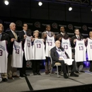 Members of the 2013 Naismith Memorial Basketball Hall of Fame class line up for a photo after inductee announcements, Monday, April 8, 2013, in Atlanta, Georgia. Shown standing behind Jerry Tarkanian from left are Edwin and Nikki Henderson representing  Dr. E.B. Henderson, Richard Guerin, Russ Granik, Sylvia Hatchell, Bernard King, Gary Payton, Rick Pitino, Dawn Staley, and CBS announcer Jim Nantz representing Guy Lewis. (AP Photo/Charlie Neibergall)