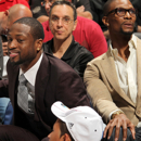 MIAMI, FL - APRIL 6:  Chris Bosh #1 and Dwyane Wade #3 of the Miami Heat look on from the bench during a game between the Philadelphia 76ers and the Miami Heat on April 6, 2013 at American Airlines Arena in Miami, Florida. (Photo by Issac Baldizon/NBAE via Getty Images)