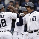 Detroit Tigers' Miguel Cabrera, right, celebrates with teammate Torii Hunter (48) after hitting a three-run home run against the Toronto Blue Jays in the fourth inning of a baseball game in Detroit, Tuesday April 9, 2013. (AP Photo/Paul Sancya)