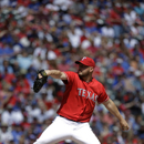 Texas Rangers' Matt Harrison (54) delivers to the Los Angeles Angels during a baseball game Saturday, April 6, 2013, in Arlington, Texas. The Angels won 8-4. (AP Photo/Tony Gutierrez)