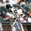 San Francisco Giants' Buster Posey hits a triple off of Colorado Rockies pitcher Jeff Francis to score Angel Pagan during the first inning of a baseball game in San Francisco, Wednesday, April 10, 2013. (AP Photo/Jeff Chiu)